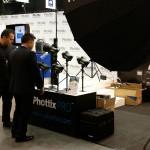 Laurence Poon, Phottix MD and Greek Wedding Photographer Nik Perkidis examine Phottix gear at the Phottix Booth at TTLHK