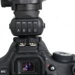 Phottix Strato II Multi Transmitter on camera with flash